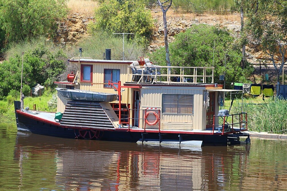 Houseboat being repaired on the water.