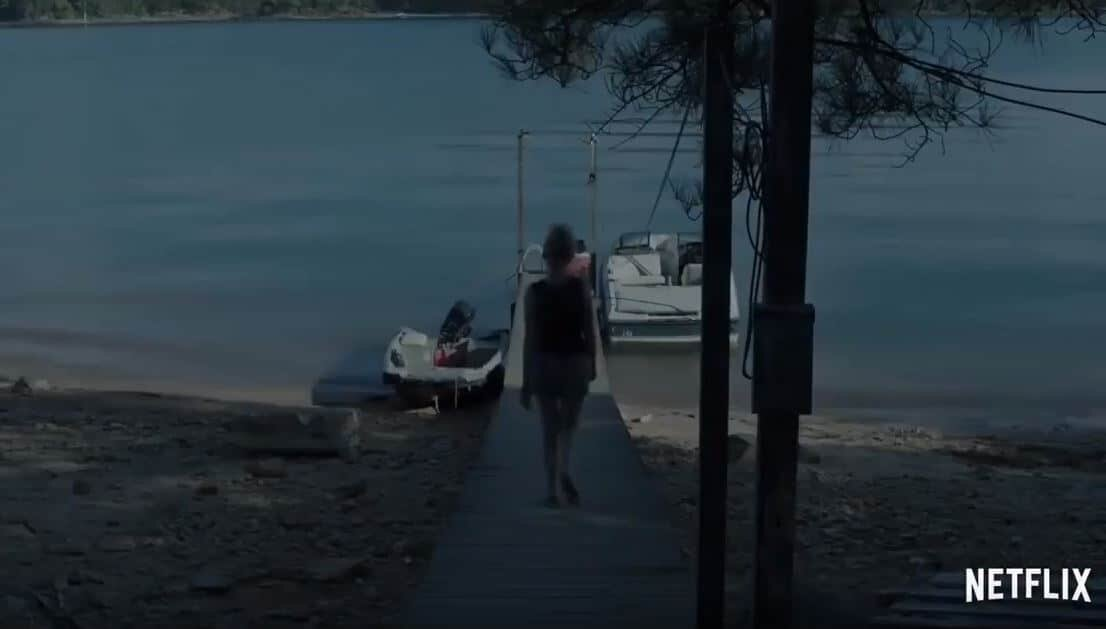Netflix Ozarks Ruth walks to the boat dock to wire it.