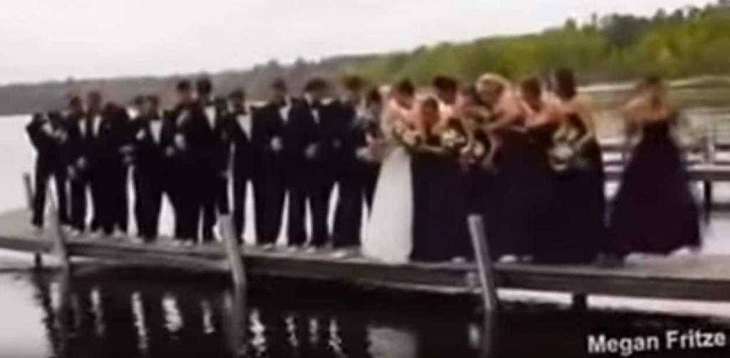 A boat dock collapses during a wedding picture.