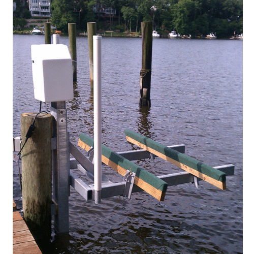 A piling mount boat lift by Magnum Lifts.