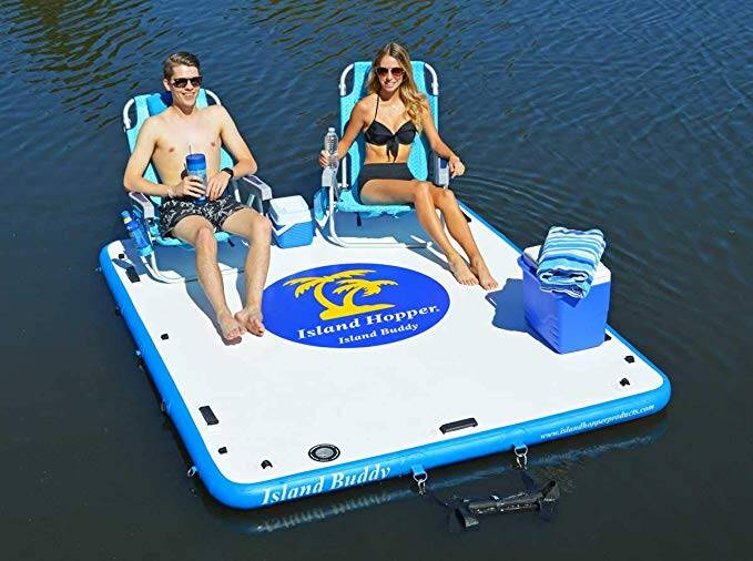 The Island Hopper Floating platform with people on. Chairs and coolers.