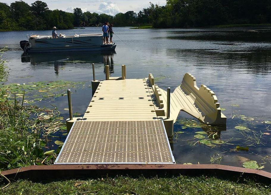 Dock building in Lake Michigan by Lake by @watersedgemmxi
