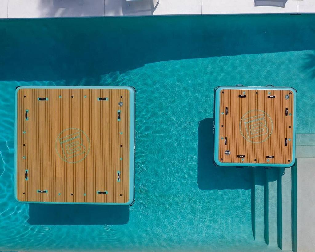 The Bote Inflatable platforms side by side: 7x7 and the 10x10