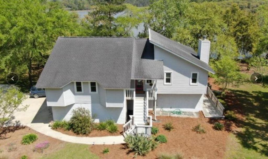 Waterfront living with 1.24 acre lot on salt water Flounder Lake! Gorgeous views, surrounded by nature and wildlife.