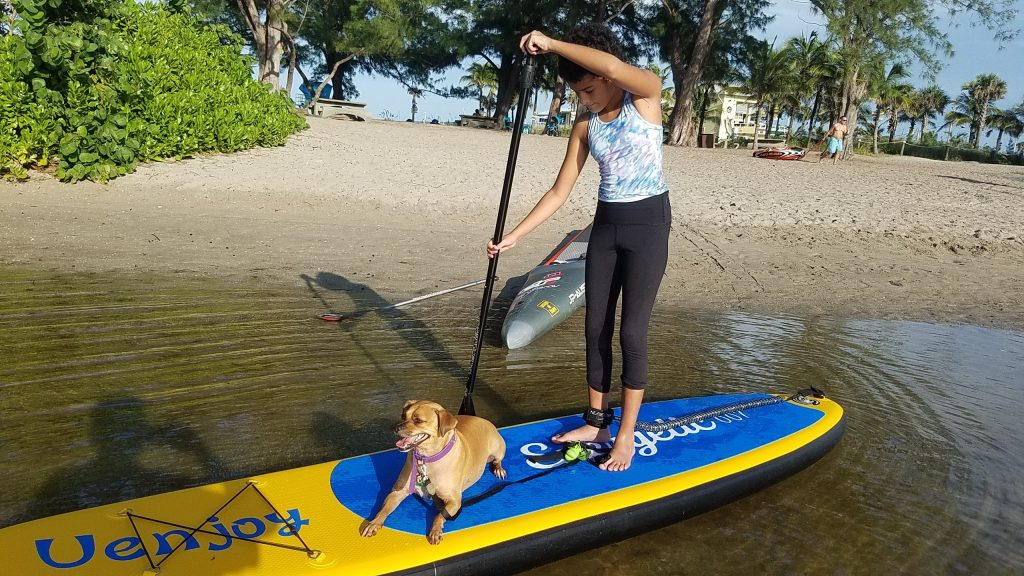 My kid and my dog on an inflatable Paddleboards.